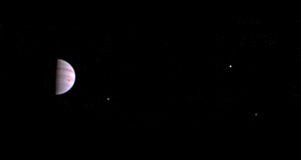 Jupiter and its Great Red Spot can be seen in this first image released by NASA. From left to right, the moons Io, Europa and Ganymede can also be seen.